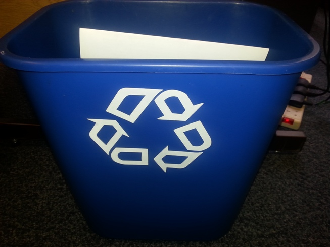 Photo of an office recycling bin